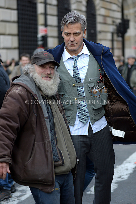 WWW.ACEPIXS.COM<br /> April 11, 2015 New York City<br /> <br /> Radioman and George Clooney on the film set of 'Money Monster' in the Financial District of Manhattan on April 11, 2015 in New York City. <br /> <br /> Please byline: Kristin Callahan/AcePictures<br /> <br /> ACEPIXS.COM<br /> <br /> Tel: (646) 769 0430<br /> e-mail: info@acepixs.com<br /> web: http://www.acepixs.com