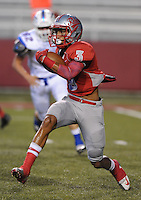 STAFF PHOTO ANDY SHUPE - Highland receiver Deon Stewart carries the ball during the first half of play against Midland Christian Monday, Sept. 1, 2014, at Razorback Stadium in Fayetteville.