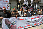 Palestinians hold placards during a protest to show solidarity with Palestinian prisoners held in Israeli Jails, in Gaza city, on April 11, 2017. Photo by Mohammed Asad