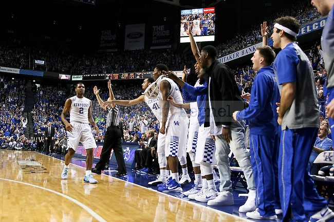 The Kentucky bench celebrates after Aaron Harrison hits the game sealing three pointer during the second half of the University of Kentucky vs. Vanderbilt game at the Rupp Arena in Lexington, Ky., on Tuesday, January 20, 2015. Photo by Jonathan Krueger | Staff
