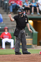 Home plate umpire Pat Sharshel makes a call during a game between the Kane County Cougars and Peoria Chiefs  on June 2, 2014 at Dozer Park in Peoria, Illinois.  Peoria defeated Kane County 5-3.  (Mike Janes/Four Seam Images)