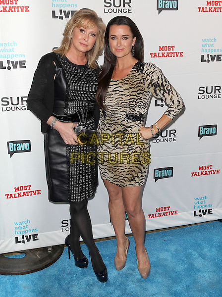 "Kathy Hilton, Kyle Richards.Bravo's Andy Cohen's Book Release Party For ""Most Talkative: Stories From The Front Lines Of Pop Held at SUR Lounge, West Hollywood, California, USA..May 14th, 2012.full length black  leather dress tiger animal print dress hand on hip beige .CAP/ADM/KB.©Kevan Brooks/AdMedia/Capital Pictures."
