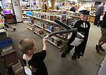 Connor Mathers, 4, and Kelton Erickson, 9, practice their Jedi skills during the Star Wars Day celebration at the Carson City Library in Carson City, Nev. on Wednesday, May 4, 2016.<br />