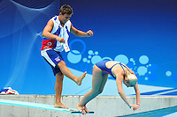 PICTURE BY ALEX BROADWAY/SWPIX.COM - Swimming - LEN European Championships Day Twelve - Diving - Budapest, Hungary - 15/08/10..Copyright - Simon Wilkinson - 07811267706...Tom Daley messes around with Megan Sylvester during a warm up session..