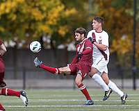 Boston College midfielder Giuliano Frano (15) flicks a pass as Virginia Tech midfielder Niels Kirch (10) defends.Boston College (maroon) defeated Virginia Tech (Virginia Polytechnic Institute and State University) (white), 3-1, at Newton Campus Field, on November 3, 2013.
