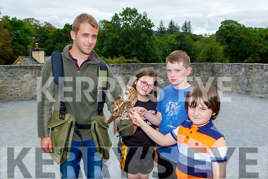 Emma O'Connor, Luca Dohery-Barron and Joey O'Connor Killarney meet Dan O'Loughlin owl at the Falconary show at Ross Castle on Sunday for Heritage Week