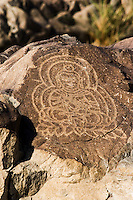 A photo of an ancient rock carving of the Buddha on the Karakoram highway in Pakistan