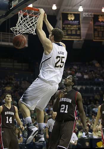 December 08, 2012:  Notre Dame forward Tom Knight (25) dunks the ball during NCAA Basketball game action between the Notre Dame Fighting Irish and the Brown Bears at Purcell Pavilion at the Joyce Center in South Bend, Indiana.  Notre Dame defeated Brown 84-57.