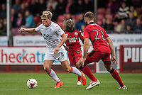 Cameron McGeehan of Luton Town (8) and Joe McNerney of Crawley Town (22)  during the Sky Bet League 2 match between Crawley Town and Luton Town at the Broadfield/Checkatrade.com Stadium, Crawley, England on 17 September 2016. Photo by Edward Thomas / PRiME Media Images.