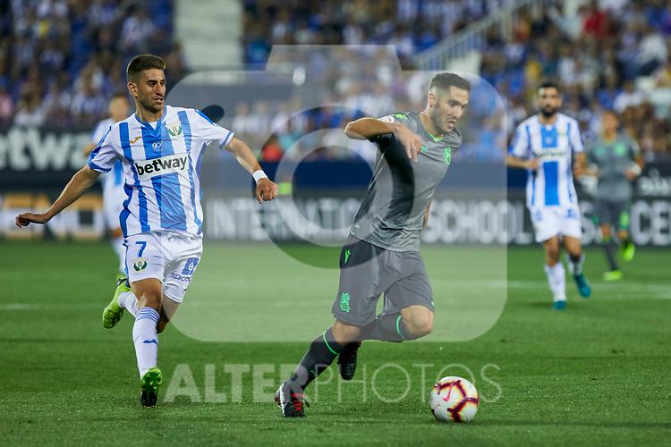 Leganes' Daniel Ojeda and Real Sociedad's Joseba Zaldua during La Liga match. August 24, 2018. (ALTERPHOTOS/A. Perez Meca)