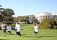 "Kids play a game in front of the White House during a  D.C United clinic in support of first lady Michelle Obama's ""Let's Move"" initiative on the White House lawn, in Washington D.C. on October 7 2010."