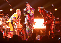 Flea, from left, and Anthony Kiedis, of Red Hot Chili Peppers, and Post Malone perform a medley at the 61st annual Grammy Awards on Sunday, Feb. 10, 2019, in Los Angeles. (Photo by Matt Sayles/Invision/AP)