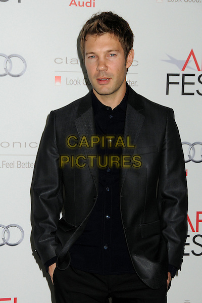 """PER SAARI, Producer.AFI Fest 2010 Screening of """"Rabbit Hole"""" held at The Egyptian Theatre, Hollywood, California, USA..November 7th, 2010.half length grey gray suit jacket shirt hands in pockets black  .CAP/ADM/BP.©Byron Purvis/AdMedia/Capital Pictures."""