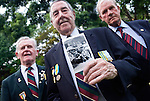 British Korean War veteran Robison Brown from Concett, County Durham holds a photo of himself and other servicemen he and John Lees from Telford (left) and Ernest Moscrop from Cambridgeshire served with in Korea while attending a commemorative event in Seoul, South Korea on 24 June 2010, the day before the 60th anniversary of the start of the Korean War..Photographer: Rob Gilhooly