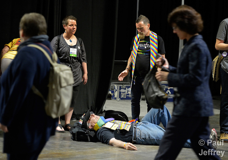 "Demonstrators hold a ""die-in"" as delegates to the 2012 United Methodist General Conference exit a plenary session in Tampa, Florida. The demonstrators are protesting the church's exclusion of gays and lesbians from full inclusion in the life and leadership of the church."