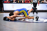 STANFORD, CA - March 7, 2020: Albert Urias of Cal State Bakersfield and Tristan Tadeo of Little Rock during the 2020 Pac-12 Wrestling Championships at Maples Pavilion.