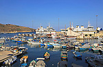 Colourful boats in harbour ferry port terminal at Mgarr, island of Gozo, Malta