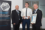 17/07/2015 The IRTE Skills Challenge 2015 prize-giving takes place at The National Motorcycle Museum, Birmingham. Gerry Fleming (left) presents the Top Scoring Bodywork Apprentice award to Michelle Wolf of FirstGroup, with John Winter of S&B (right).