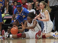 STANFORD, CA - January 20, 2011: Nnemkadi Ogwumike grabs a loose ball during Stanford's 64-38 victory over UCLA at Stanford, California on January 20, 2011.