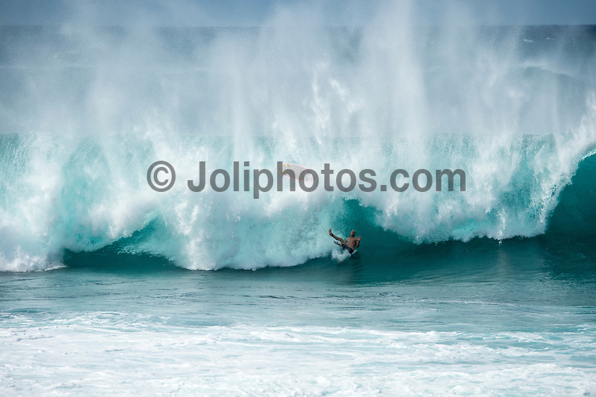 BANZAI PIPELINE, Oahu/Hawaii (Saturday, December 13, 2014)  Jamie O'Brien (HAW) riding a soft top surfbaord at Pipeline after the contest was called off for the day. - The final stop of the 2014  World Championship Tour, the Billabong Pipe Masters in Memory of Andy Irons, was  called ON today in NW double overhead surf. <br /> Round 1 was completed as the swell continued to rise and the Easterly Trade winds increased in strength. Kelly Slater (USA) kept his World Title hopes alive after winning his heat against Reef MacIntosh (HAW). Jordy Smith(ZAF) was injured when he hit the reef at Backdoor.<br /> Conditions worsen around the end of the Round and the event was first put on hold then postponed for the day.  <br /> <br /> The Billabong Pipe Masters in Memory of Andy Irons will determine this year&rsquo;s world surfing champion as well as those who qualify for the elite tour in 2015. As the third and final stop on the Vans Triple Crown of Surfing Series  the event will also determine the winner of the revered three-event leg.<br /> <br />  Photo: joliphotos.com