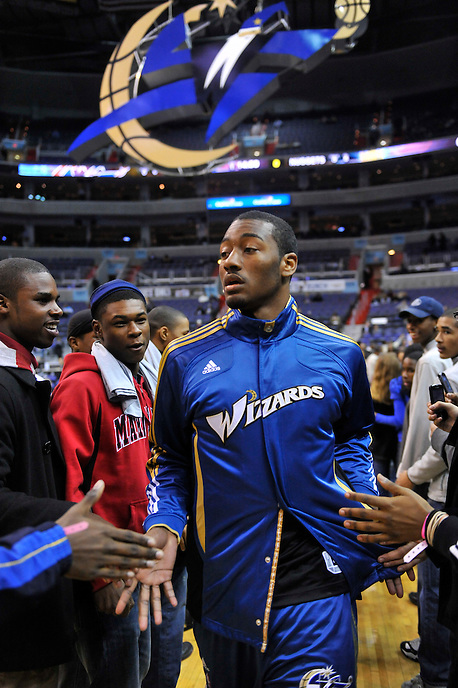 John Wall enters the arena and high-fives fans as the Wizards gets ready to take on the Nuggets at the Verizon Center in Washington, D.C. on Tuesday, January 25, 2011.  Alan P. Santos/DC Sports Box