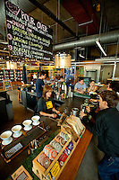 Interior photography of Not Just Coffee, a shop located inside of the 7th Street Public Market in Uptown Charlotte, North Carolina. Building upon the success of Charlotte's Center City Green Market, the Seventh Street Public Market opened in 2012 to be a year-round market serving and celebrating local food artisans, entrepreneurs and local and regional farmers. Image is part of a series of photos taken of the Center City attraction.