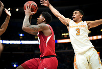 NWA Democrat-Gazette/CHARLIE KAIJO Arkansas Razorbacks forward Darious Hall (20) reaches for a layup as Tennessee Volunteers guard James Daniel III (3) covers during the Southeastern Conference Men's Basketball Tournament semifinals, Saturday, March 10, 2018 at Scottrade Center in St. Louis, Mo. The Tennessee Volunteers knocked off the Arkansas Razorbacks 84-66