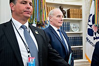 John Kelly, White House chief of staff, stands in the Oval Office of the White House during a meeting with U.S. President Donald Trump and Stefan Lofven, Sweden's prime minister, not pictured, in Washington, D.C., U.S., on Tuesday, March 6, 2018. Trump and Lofven are looking to focus on trade and investment between the two countries and ways to achieve shared defense goals. <br /> CAP/MPI/RS<br /> &copy;RS/MPI/Capital Pictures