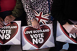 A woman with a 'Vote No' sign and a bag bearing a British flag, at an anti-Scottish independence Better Together rally at Community Central Hall, Glasgow. The event was staged by Better Together who were campaigning to prevent an independent Scotland from leaving the United Kingdom. On the 18th of September 2014, the people of Scotland voted in a referendum to decide whether the country's union with England should continue or Scotland should become an independent nation once again.