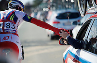 Vladimir Isaychev (RUS/Katusha) returning stuff to the car<br /> <br /> Omloop Het Nieuwsblad 2015