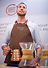 The London Coffee Festival <br /> Truman Brewery, Brick Lane, London, Great Britain <br /> 6th April 2017 <br /> <br /> General atmosphere on the opening day of the London Coffee Festival <br /> a barista from Union Coffee about to demonstrate making coffee<br /> <br /> <br /> Photograph by Elliott Franks <br /> Image licensed to Elliott Franks Photography Services