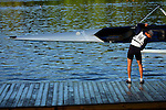 A rower from Sonoma helps launch the Men's Varsity Heavyweight Four boat during the 68th Dad Vail Regatta on the Schuylkill River in Philadelphia, Pennsylvania on May 12, 2006........