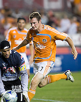 Houston Dynamo forward Nate Jaqua (27) makes a run on goal as Pachuca FC goalkeeper Miguel Calero (1) makes the save.  Houston Dynamo defeated Pachuca FC 2-0 in the semifinals of the Superliga 2008 tournament at Robertson Stadium in Houston, TX on July 29, 2008.