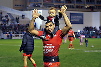 Bryan Habana of Toulon salutes the crowd with his son on his shoulders. European Rugby Champions Cup match, between RC Toulon and Bath Rugby on January 10, 2016 at the Stade Mayol in Toulon, France. Photo by: Patrick Khachfe / Onside Images