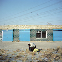 A migrant worker takes a nap at an empty workshop before it is demolished for redevelopment on the outskirts of Beijing, China in January, 2011. (Mamiya 6, 75mm f3.5, Kodak Ektar 100 film)