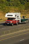 Pickup hauling slide-in camper and towing boat