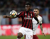Calcio, Serie A: Milano, stadio Giuseppe Meazza (San Siro), 1 ottobre 2017.<br /> Milan's Franck Kessi&eacute; (l) in action with Aleksandar Kolarov (r) during the Italian Serie A football match between Milan and AS Roma at Milan's Giuseppe Meazza (San Siro) stadium, October 1, 2017.<br /> UPDATE IMAGES PRESS/IsabellaBonotto