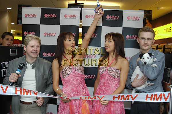 THE CHEEKY GIRLS.At HMV Boston, England..September 1st, 2004.Ref: HT.Monica Gabriella twins sisters half length pink dress cutting ribbon halterneck arm in air.www.capitalpictures.com.sales@capitalpictures.com.©Capital Pictures