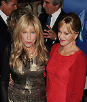 BEVERLY HILLS, CA- OCTOBER 30: Singer Carly Simon (L) and actress Melanie Griffith arrive at the Oceana Partners Award Gala With Former Secretary Of State Hillary Rodham Clinton and HBO CEO Richard Plepler at Regent Beverly Wilshire Hotel on October 30, 2013 in Beverly Hills, California.