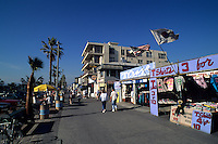 Famous Boardwalk on wild Venice Beach in Los Angeles California home of muscle beac