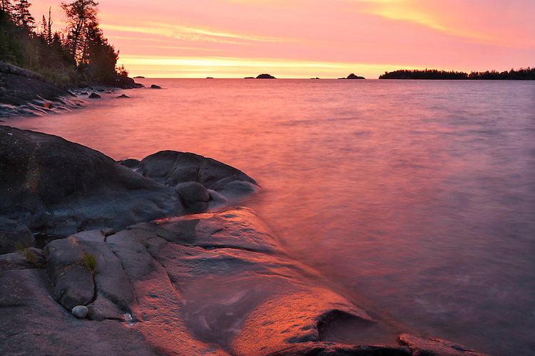 Sunrise glow on the shore of Lake Superior in Rock Harbor; Isle Royale National Park, MI