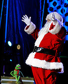 Kermit the Frog and Santa Claus perform during the 2011 National Christmas Tree Lighting on the Ellipse in Washington, DC, on Thursday, December 1, 2011.   .Credit: Roger L. Wollenberg / Pool via CNP