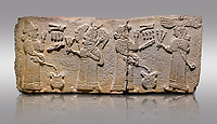 Aslantepe Monumental Hittite relief sculpted orthostat stone panel.  Limestone, Aslantepe, Malatya, 1200-700 B.C. <br /> <br /> Scene of the king's offering drink and sacrifice to the gods. The king offers to the winged god of the moon who stands across and holds a lightning bundle in his hand. Behind the king is the queen, who also offers to goddess of the sun holding a sceptre in his hand. King's left hand is in a position to worship. <br /> <br /> Against a gray background.