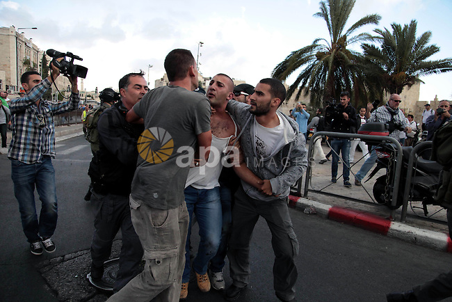 Undercover Israeli policemen detain a Palestinian man during clashes between Israeli security forces and Palestinian protesters outside Damascus Gate in Jerusalem's Old City September 24, 2013. Some 300 Palestinians protested on Tuesday against Israel's admittance of visitors to a holy site in Jerusalem's Old City which houses the al-Asqa mosque, and which Jews revere as the vestige of their ancient temples. An Israeli police spokesman said two protesters were detained after they threw stones. Photo by Saeed Qaq
