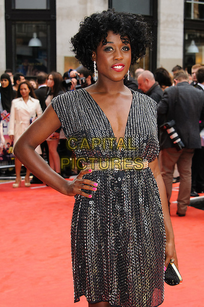 Lashana Lynch.The 'Fast Girls' UK film premiere, Odeon West End cinema, Leicester Square, London, England..June 7th, 2012.half gold belt length sleeveless dress black sequins sequins hand on hip.CAP/CJ.©Chris Joseph/Capital Pictures.