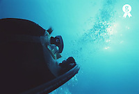 Scuba diver looking towards surface, underwater view, close-up (Licence this image exclusively with Getty: http://www.gettyimages.com/detail/200387998-001 )