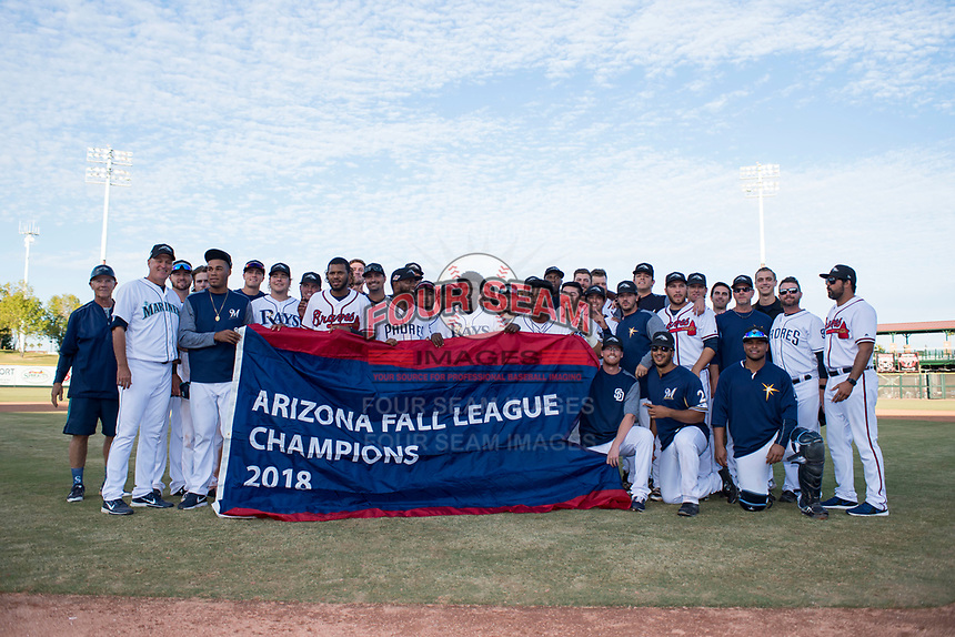 The Peoria Javelinas pose for a team photo with the championship banner after winning the Arizona Fall League Championship Game against the Salt River Rafters at Scottsdale Stadium on November 17, 2018 in Scottsdale, Arizona. Peoria defeated Salt River 3-2 in 10 innings. Davidson broke his left foot while rounding second base. (Zachary Lucy/Four Seam Images)