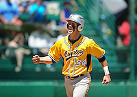May 31, 2010; Grand Junction, CO, USA; Southern Nevada Coyotes catcher Bryce Harper celebrates after stealing home in the first inning against the Faulkner State Sun Chiefs during the Junior College World Series as Suplizio Field. Southern Nevada won the game 18-1. Mandatory Credit: Mark J. Rebilas-