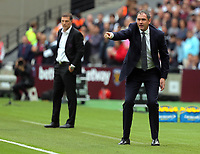 Swansea manager Paul Clement gives instructions to his players from the touch line during the Premier League match between West Ham United v Swansea City at the London Stadium, London, England, UK. Saturday 30 September 2017