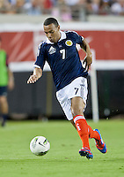 May 26, 2012:   Scotland Matt Phillips (7) dribbles the ball downfield during action between the USA and Scotland at EverBank Field in Jacksonville, Florida.  USA defeated Scotland 5-1.............